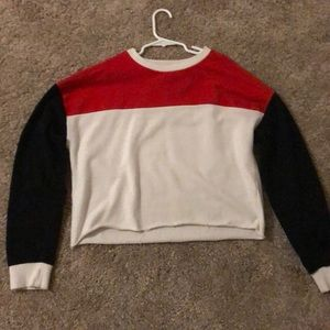 A black, red white long sleeve crop top.